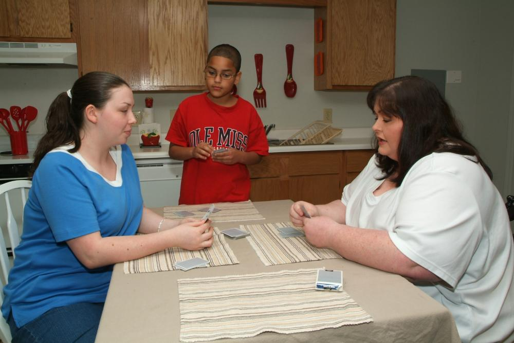 Stephanie Williams with her family in a Carpenter Estates apartment.